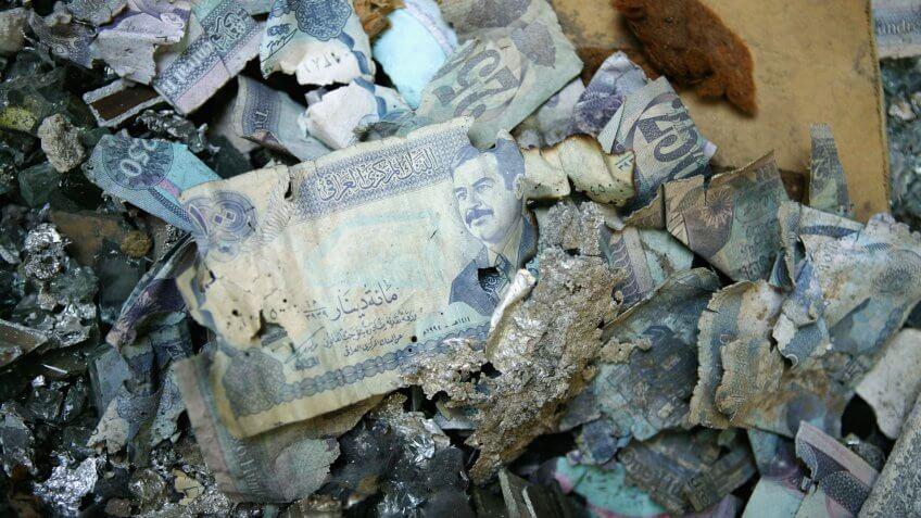BAGHDAD, IRAQ - JUNE 2: Iraqi dinars lay on the floor of the Central Bank of Iraq June 2, 2004 in Baghdad, Iraq.