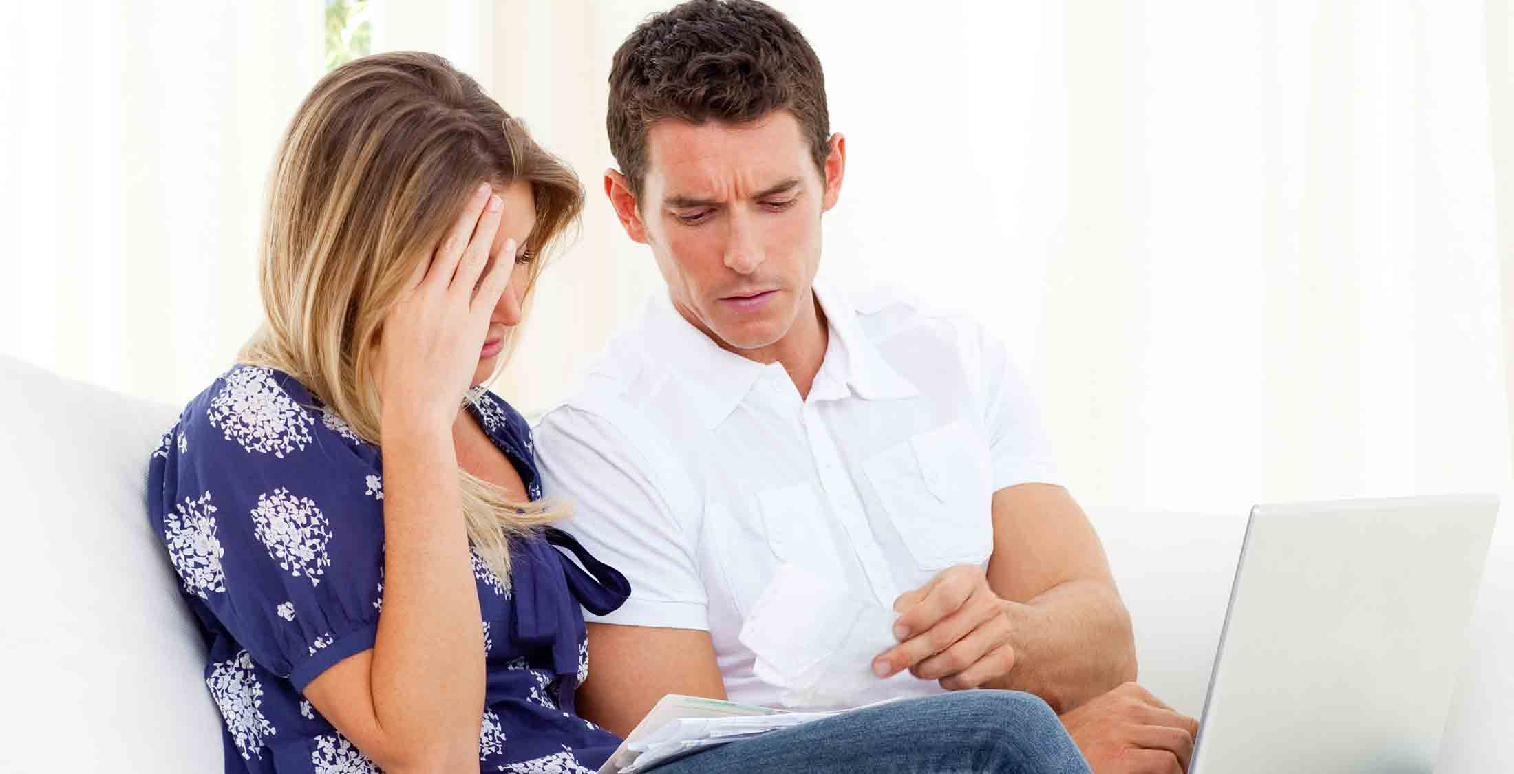 frustrated couple paperwork mortgage loan