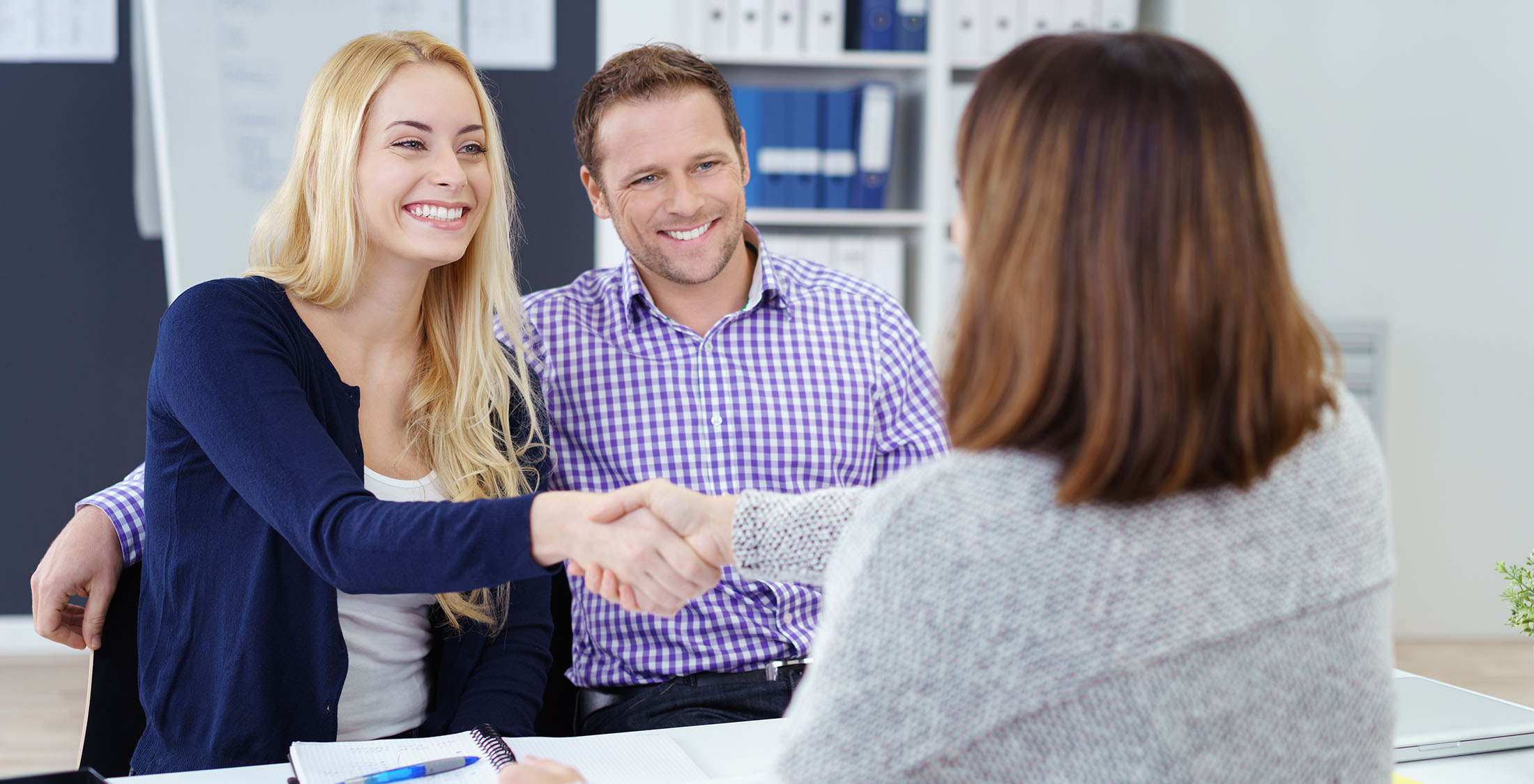 couple shaking hands with advisor