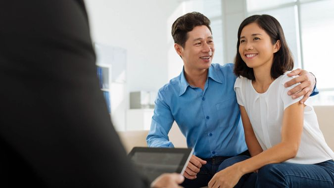 happy couple meeting real estate