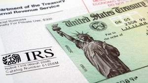 How to Decide If Your Tax Refund Should Go to Your Savings Account or Debt Payments