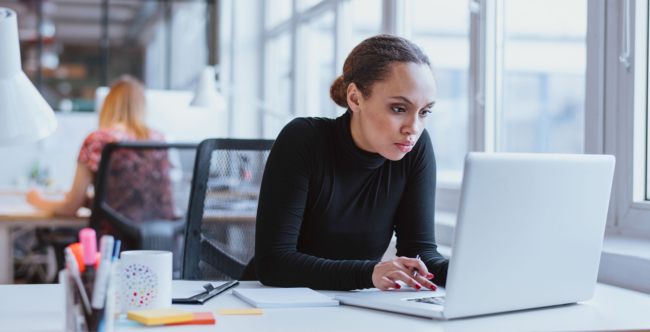 woman focused on computer at work