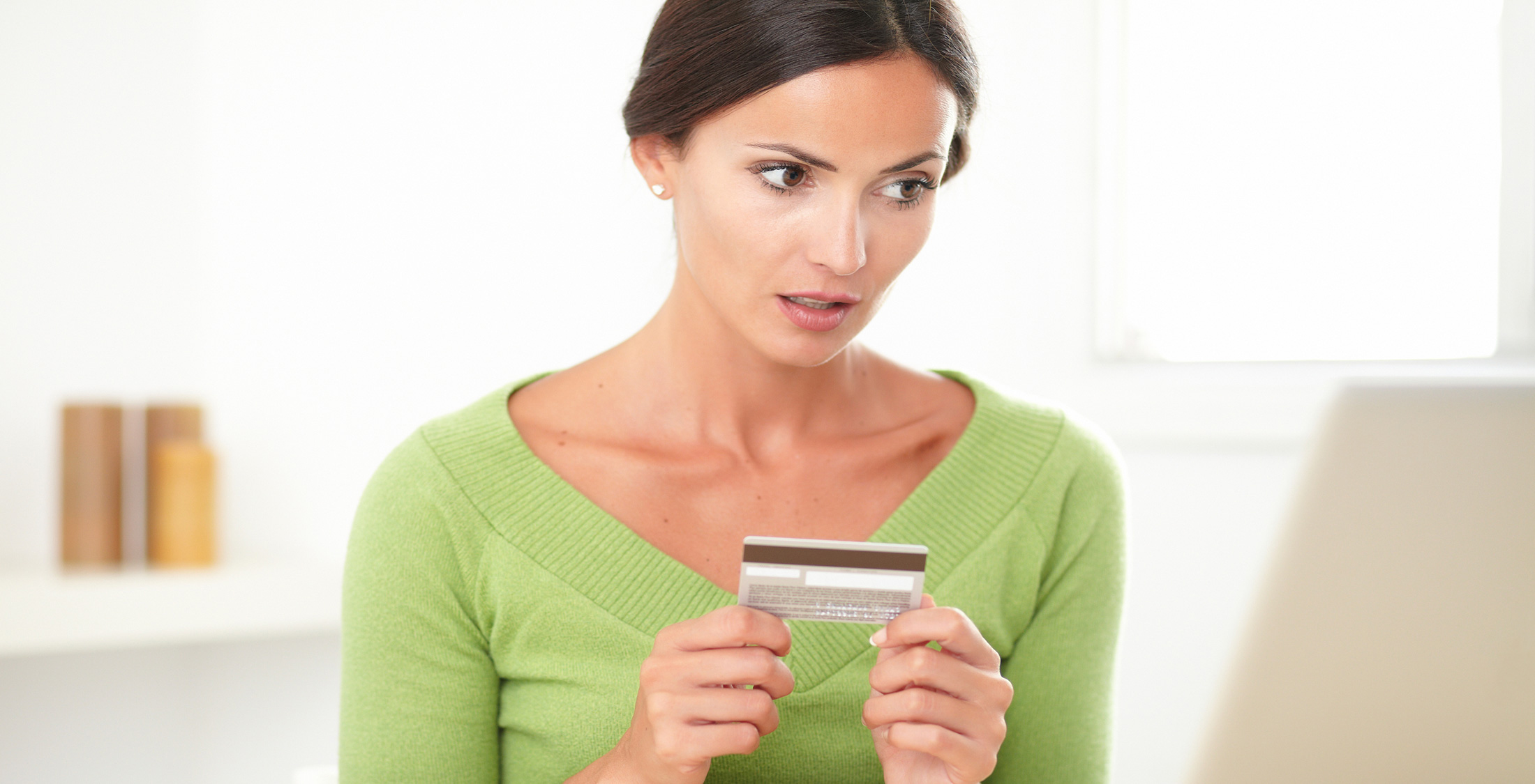 woman disappointed at credit card