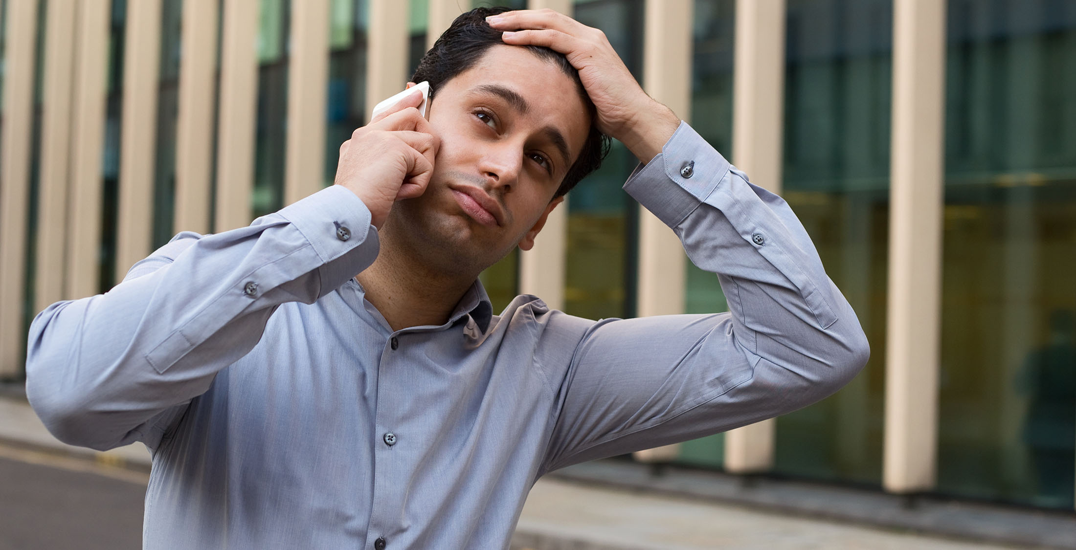 man frustrated on phone call