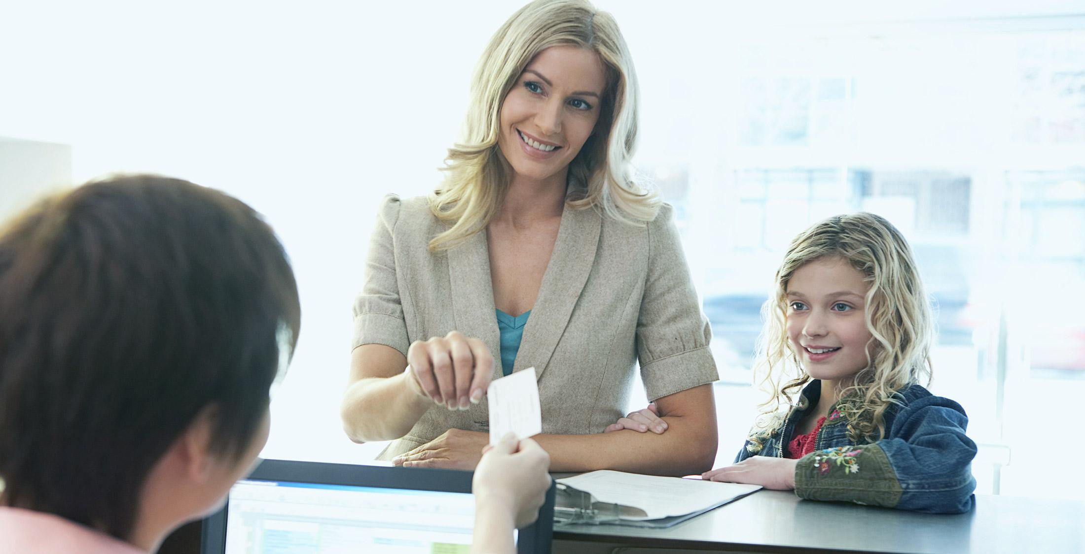 woman and girl checking account
