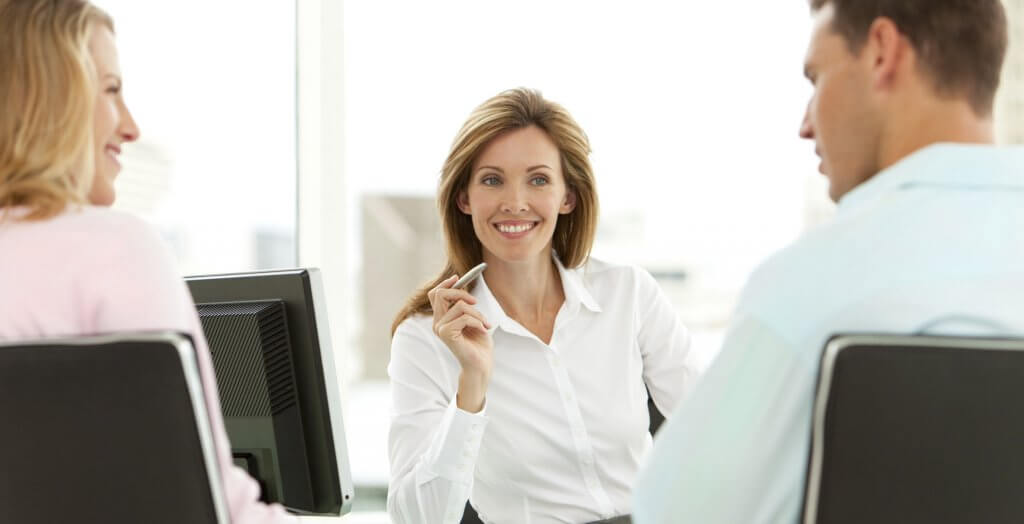 businesswoman meeting with couple