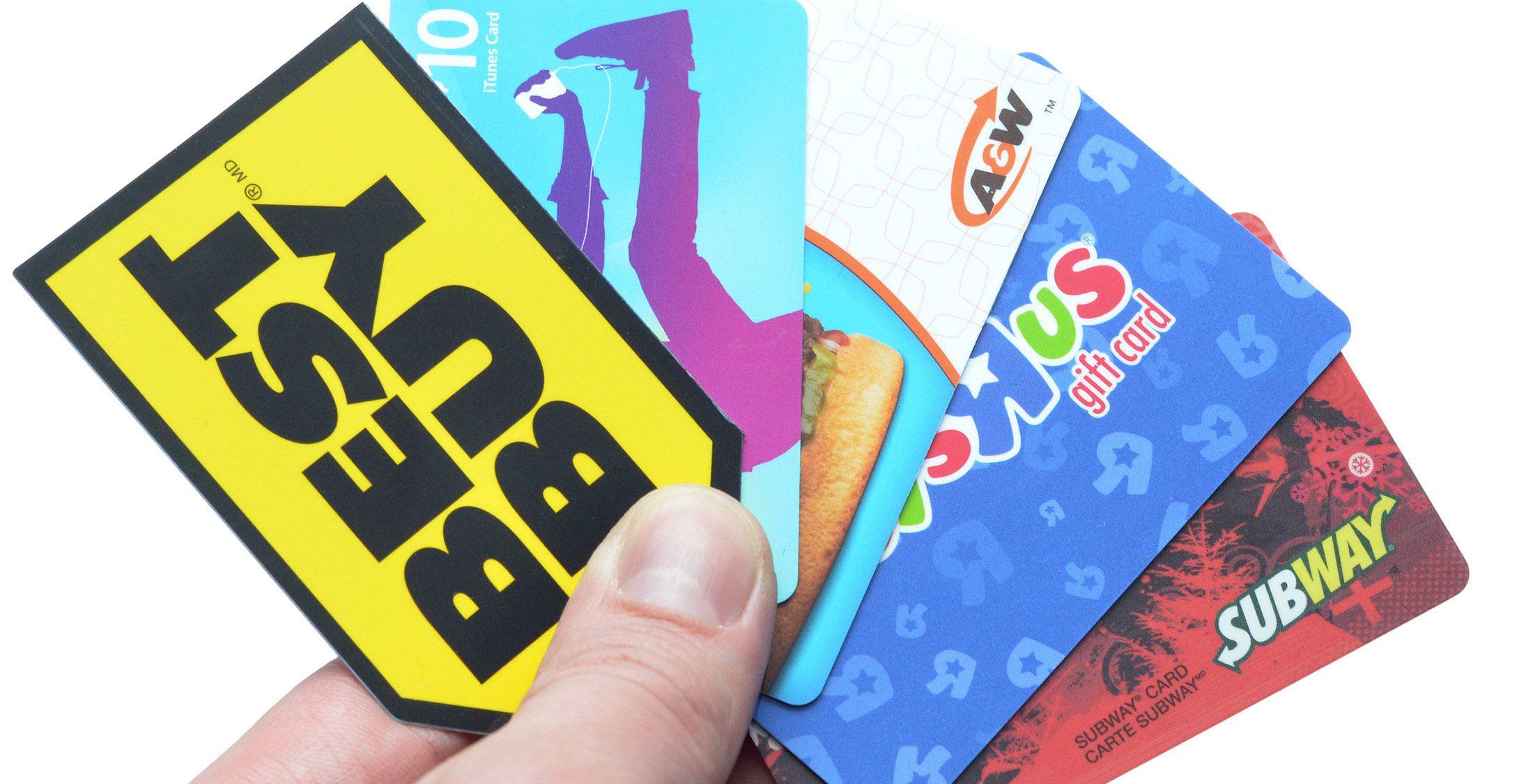 best buy itunes subway gift cards in hand