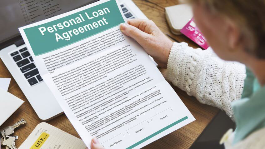 woman reading a personal loan agreement contract