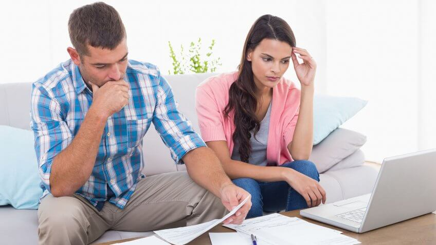 stressed couple going over finances