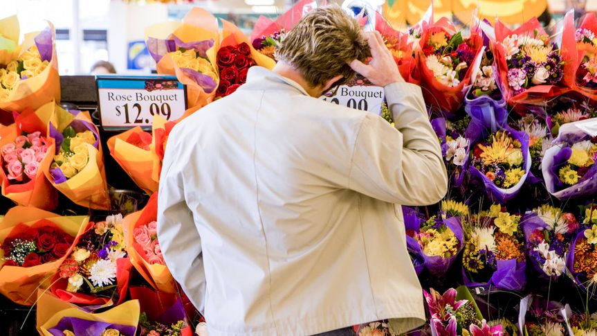 man shopping for valentine's day flowers