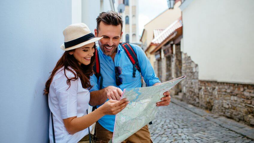 vacationing couple looking at a map