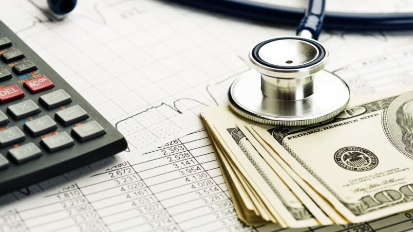 cash, a calculator and a stethoscope