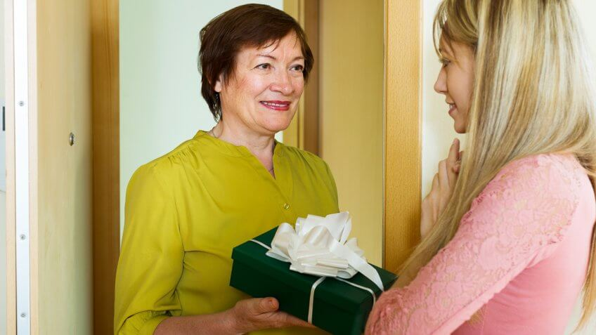woman giving another woman a gift
