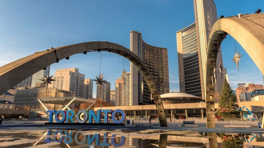 Canada., How Much to Tip When Traveling to These 25 Countries, Toronto City Hall on Nathan Phillips Square at sunset