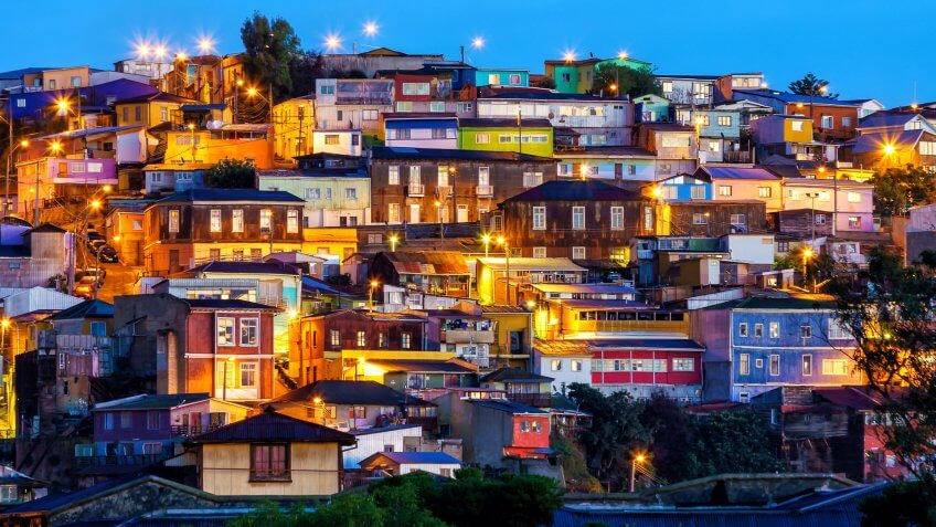 How Much to Tip When Traveling to These 25 Countries, The historic quarter of Valparaiso in Chile at night