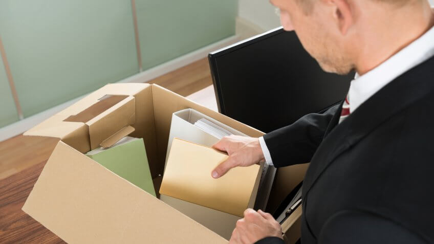 Man packing up documents into box