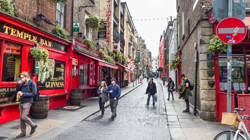 2016: Tourists walking in the Temple Bar area. The place is the , DUBLIN, How Much to Tip When Traveling to These 25 Countries, IRELAND - 05 MAY, bars and nightclubs.