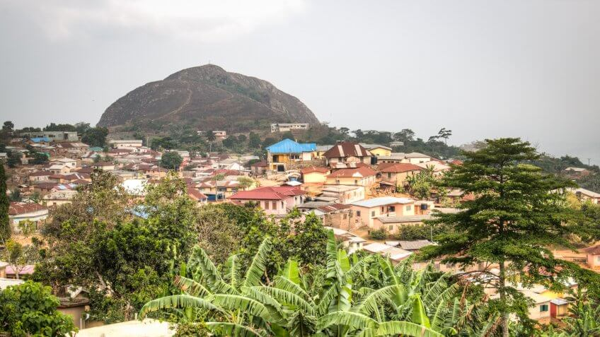 View over the town of Amedzofe with its green surroundings and the mountain in the background in the Volta Region, Ghana.