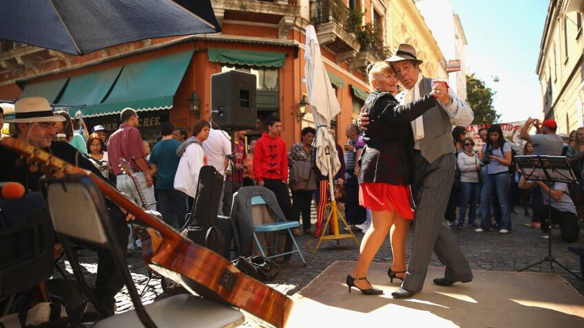 BUENOS AIRES, ARGENTINA - SEPTEMBER 08:  Dancers perform a Tango at Plaza Dorrego in San Telmo on September 8, 2013 in Buenos Aires, Argentina.