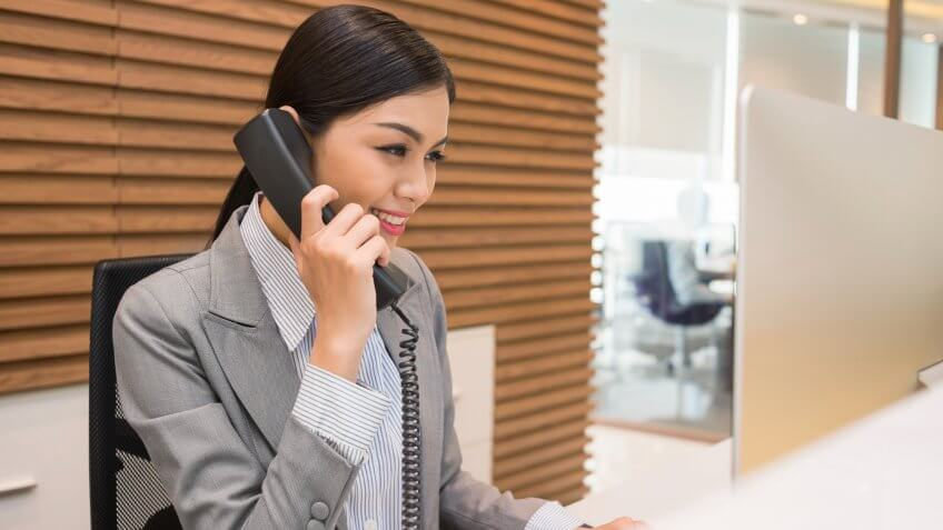 Woman in office answering a phonecall