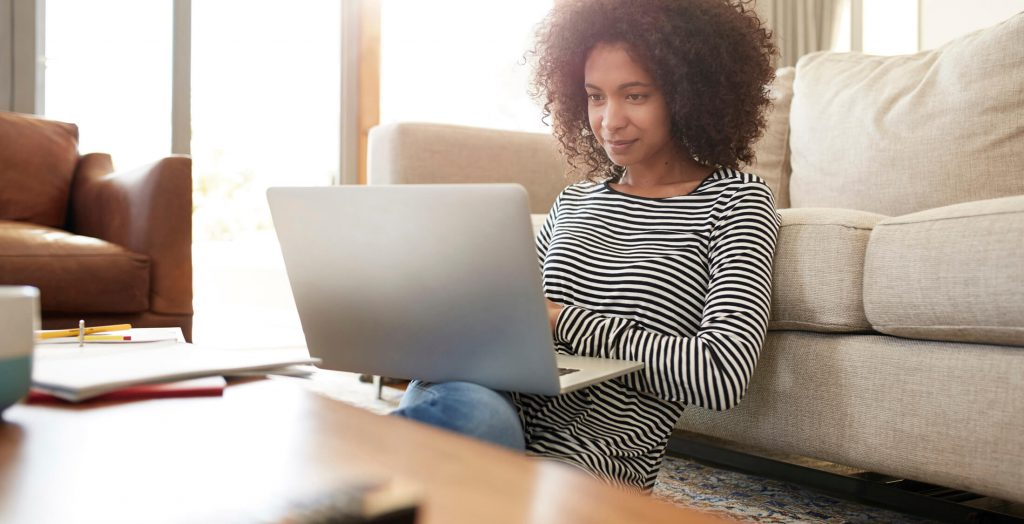 woman on laptop in home