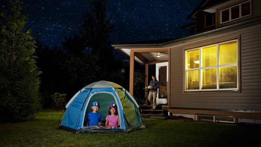 kids camping in the backyard in a tent