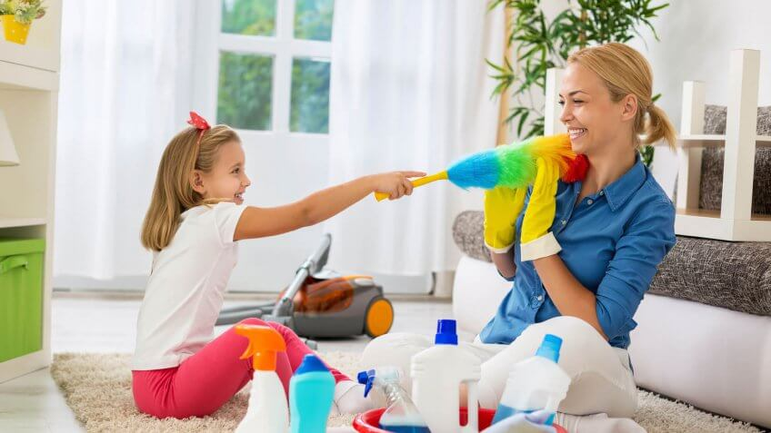 mother cleaning the house with daughter
