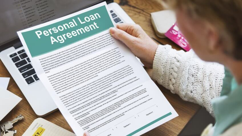 woman holding personal loan agreement