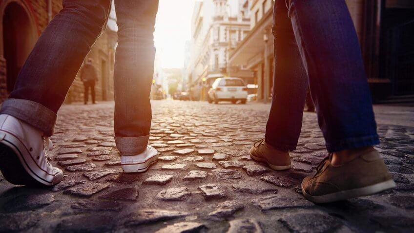 walking down a cobblestone street