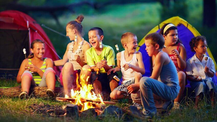 kids' summer camp around a fire