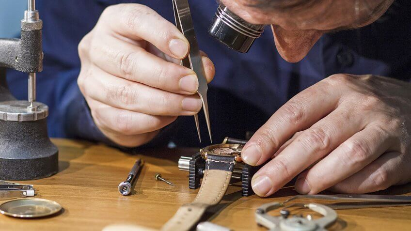 A man repairing a watch.
