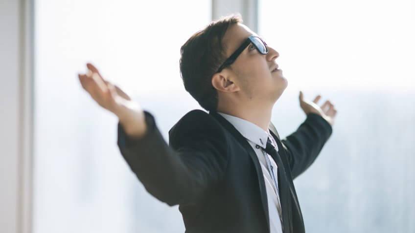 businessman raised hands.