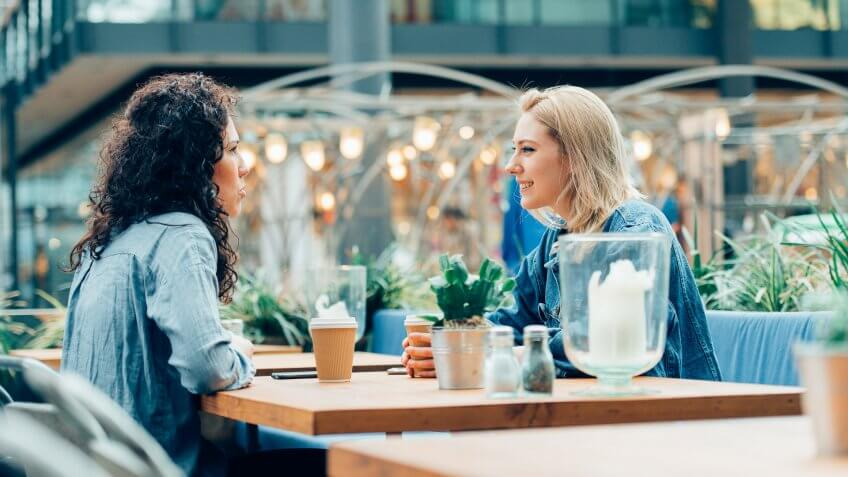 Two women drinking coffee at a cafe