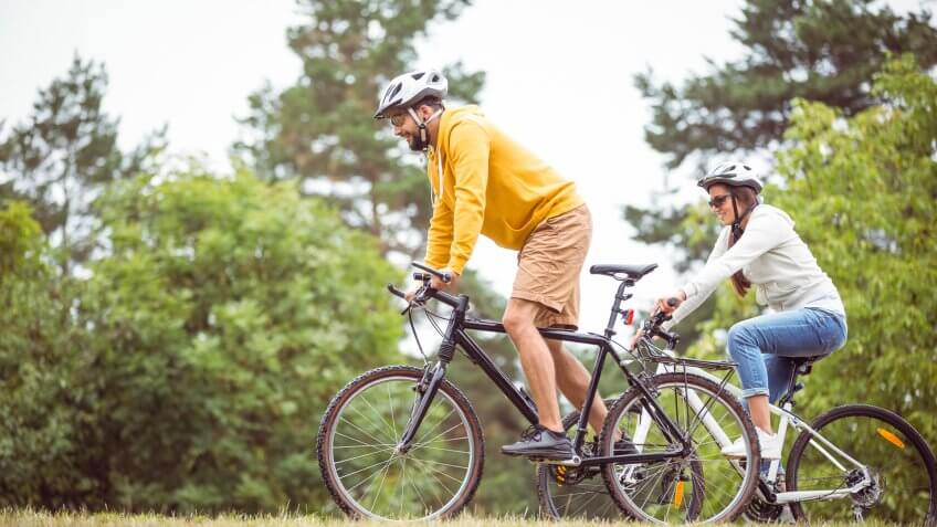 man and woman biking in nature outdoors