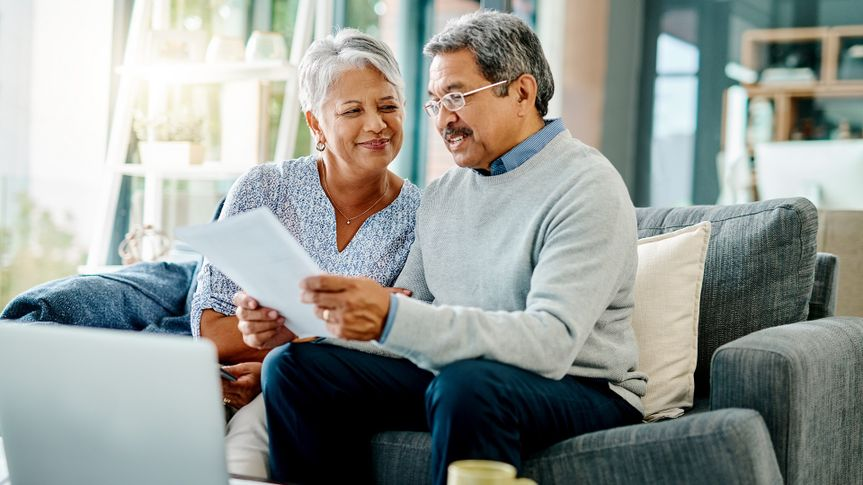 Shot of a mature couple going through paperwork together at home