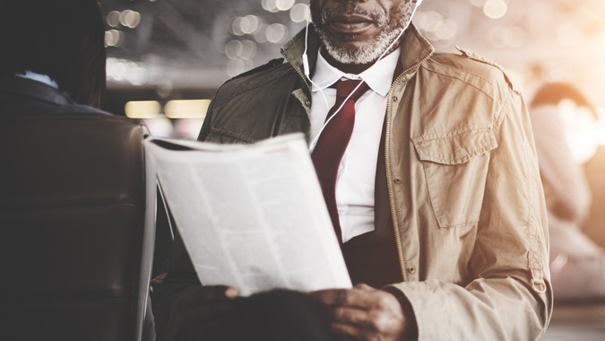 Businessman Waiting Station Reading Travel Concept.
