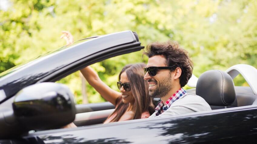 Couple in convertible on their road trip.