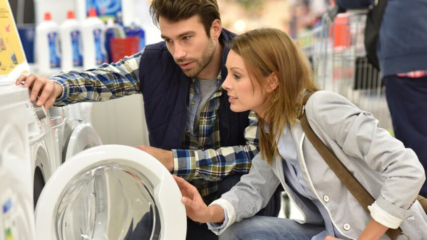 couple buying washing machine