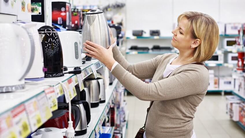 woman shopping for water boiler