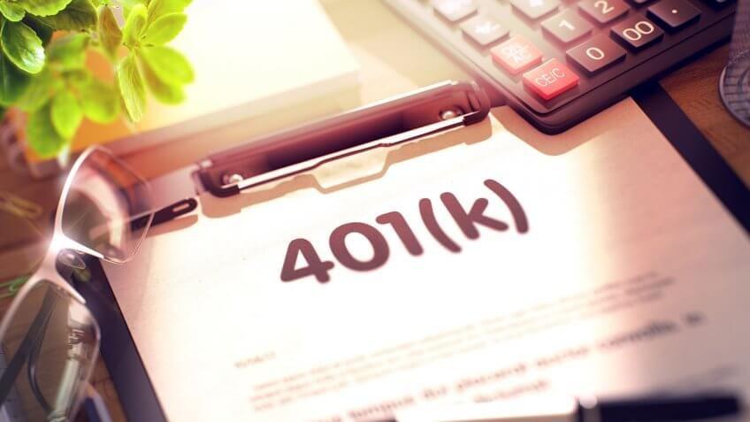 401k paperwork on desk with glasses