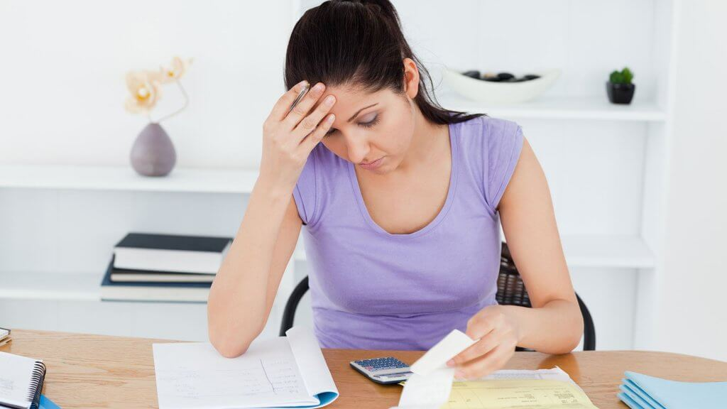 stressed woman looking over finances