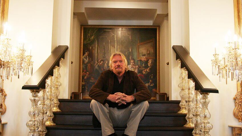 Richard Branson sitting on stairs