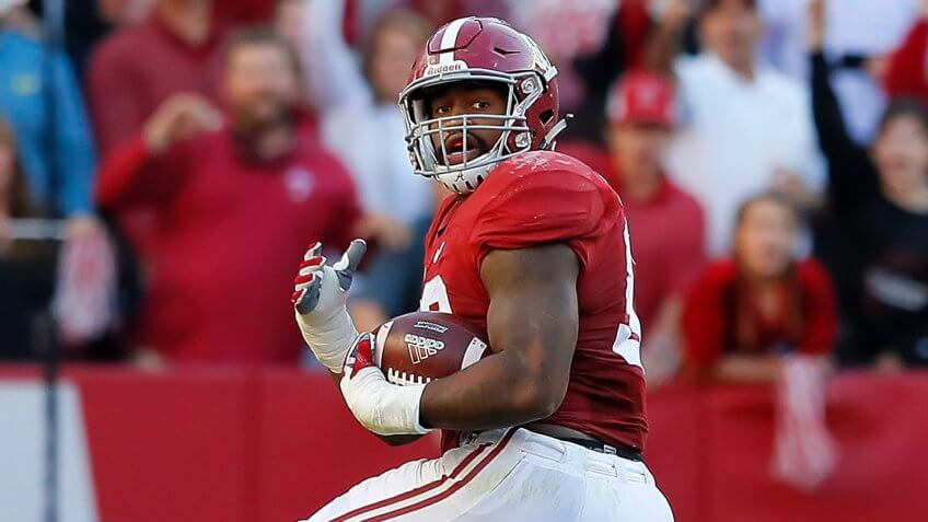 TUSCALOOSA, AL - OCTOBER 22:  Jonathan Allen #93 of the Alabama Crimson Tide returns a fumble for a touchdown as he steps over Trevor Knight #8 of the Texas A&M Aggies at Bryant-Denny Stadium on October 22, 2016 in Tuscaloosa, Alabama.