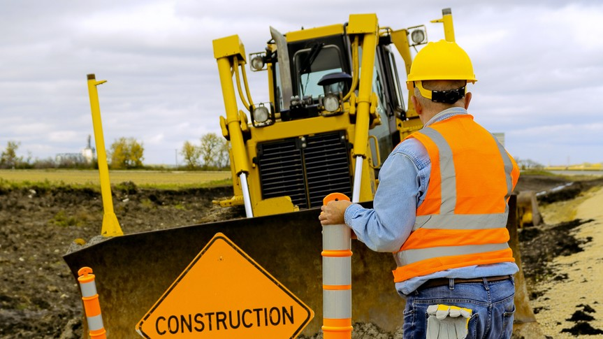 construction workers with machinery