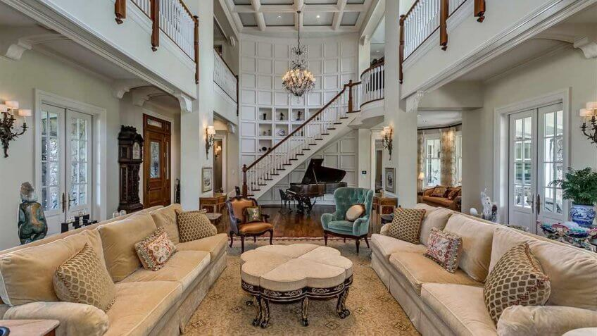 open living room in Alabama mansion with a second floor balcony