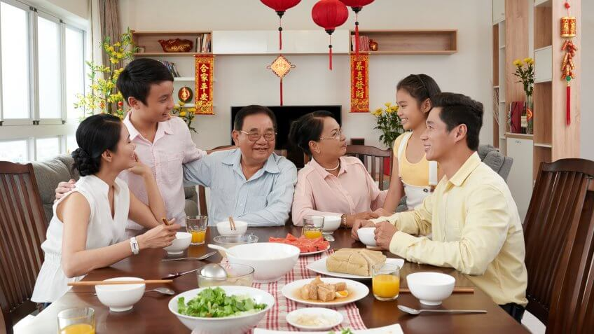 Asian family eating dinner together