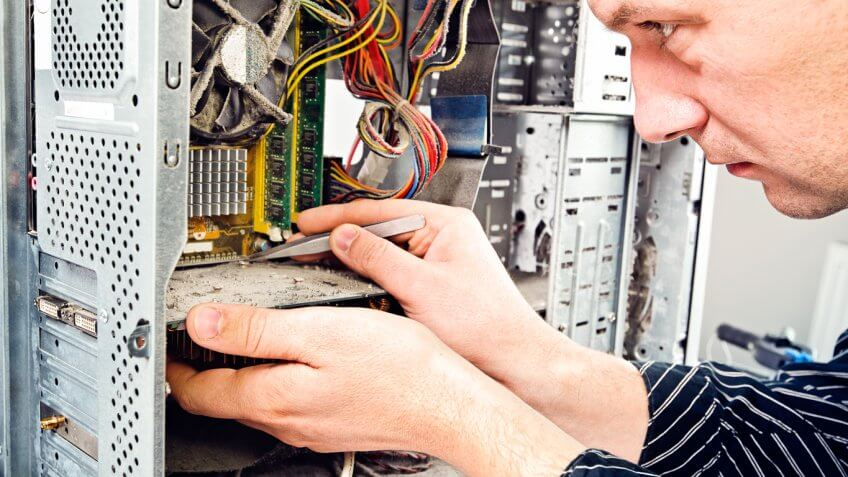 man working on inside of computer tower