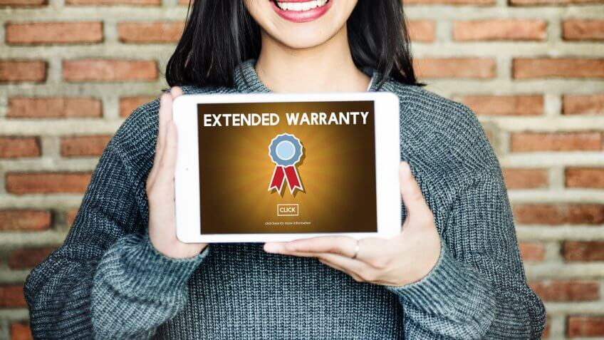 woman holding up tablet with warranty graphic