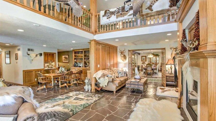 living room with a second floor balcony in Nebraska