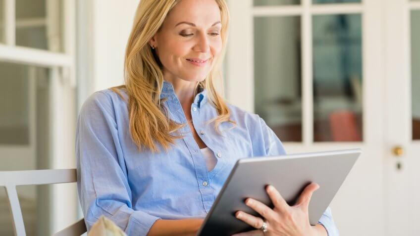 Portrait of a business woman using tablet